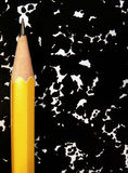 Pencil and notebook. Pencil on composition book royalty free stock photo