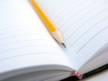 Pencil and notebook Royalty Free Stock Images