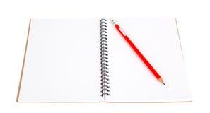 Pencil on notebook Stock Photos