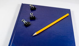 Pencil notebook binder. Pencil on a notebook and binder Royalty Free Stock Photo