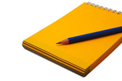 Pencil on a notebook isolated. Pencil on a empty yellow notebook. Isolated on white Royalty Free Stock Photography