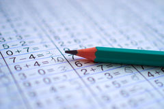 Pencil is on notebook with mathematical examples. The pencil is on the notebook with mathematical examples royalty free stock photos