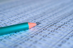 Pencil is on notebook with mathematical examples. The pencil is on the notebook with mathematical examples royalty free stock photography