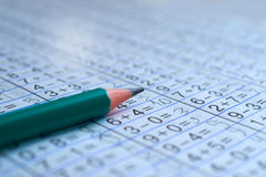Pencil is on notebook with mathematical examples. The pencil is on the notebook with mathematical examples royalty free stock images