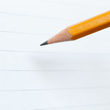 Pencil and notebook paper Stock Photos