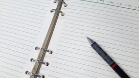 A pencil on notebook. Stock Photography