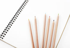 Pencil and notebook Stock Photography