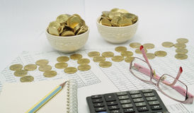 Pencil on notebook and spectacles with coins put as money Stock Photography