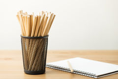 Pencil and notebook Stock Photos