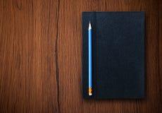 Pencil with notebook Stock Photos
