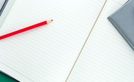 Pencil and notebook Stock Image