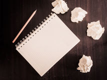 Pencil and notebook on wood texture Royalty Free Stock Photo