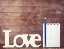 Pencil and notebook with word Love Royalty Free Stock Photo
