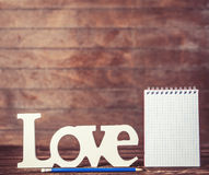 Pencil and notebook with word Love Royalty Free Stock Images