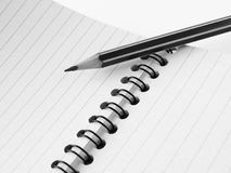 Pencil and notepad Royalty Free Stock Image