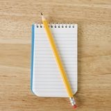 Pencil on notepad. Royalty Free Stock Photos