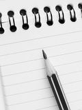Pencil and notepad Stock Image