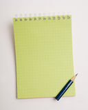 Pencil on the notepad composition Royalty Free Stock Images
