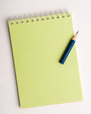 Pencil on the notepad composition Royalty Free Stock Photos