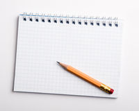 Pencil on the notepad composition Stock Image