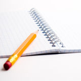 Pencil on the notepad composition Stock Photo