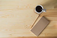 Pencil, notepad and cup of coffee. Top view flat lay of notebook, pencil, cup of coffee on wooden table with copy space Stock Images