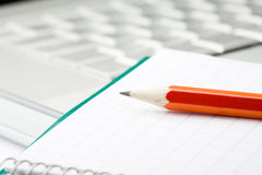 Pencil, notepad and laptop. Royalty Free Stock Images