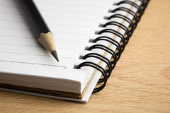 Pencil on the notepad Royalty Free Stock Images