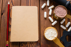 Pencil and notepad near the protein and amino. Acids Royalty Free Stock Images