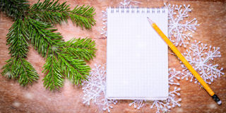 Pencil and Notepad on old rustic table decorated with a fir bran Stock Image