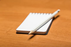 Pencil and notepad Royalty Free Stock Images
