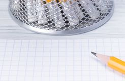 Pencil for notes on a sheet of clean white paper royalty free stock photography