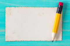Pencil with old paper on the blue surface Stock Images