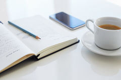 Pencil, open diary and coffee cup with sketch websites Royalty Free Stock Image
