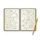 Pencil and open notebook with painted arrows Stock Images
