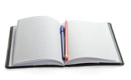 Pencil on the open notepad Royalty Free Stock Images
