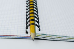 Pencil in opened notebook. Stock Photos
