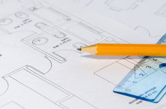 Pencil over a Blueprint. A pencil and a ruler on top of building plan royalty free stock photo