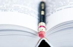Pencil on pages of the book Royalty Free Stock Images