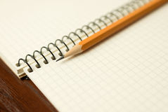Pencil on the pages of an open notebook for records Royalty Free Stock Photo