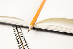 Pencil on the pages of an open notebook for records Royalty Free Stock Photos
