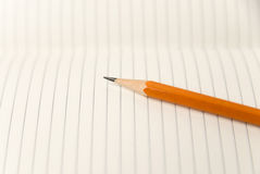 Pencil on the pages of an open notebook for records Royalty Free Stock Photography