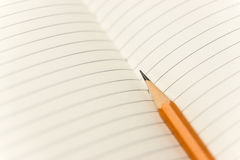 Pencil on the pages of an open notebook for records Stock Images