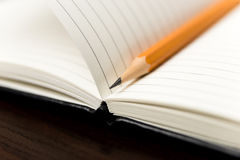 Pencil on the pages of an open notebook for records Royalty Free Stock Images
