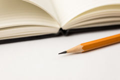 Pencil on the pages of an open notebook for records Stock Photography
