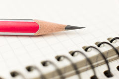 Pencil on the pages of an open notebook for records Royalty Free Stock Image