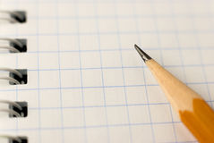 Pencil on the pages of an open notebook for records Stock Photos