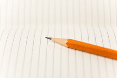 Pencil on the pages of an open notebook for records Stock Image