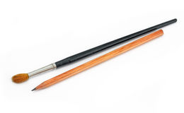 Pencil and paint brushes Stock Photography