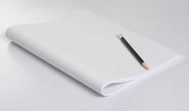 Pencil & paper. Pencil & white paper on plane background Stock Image